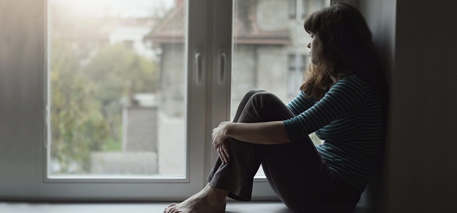 Lonely woman at home